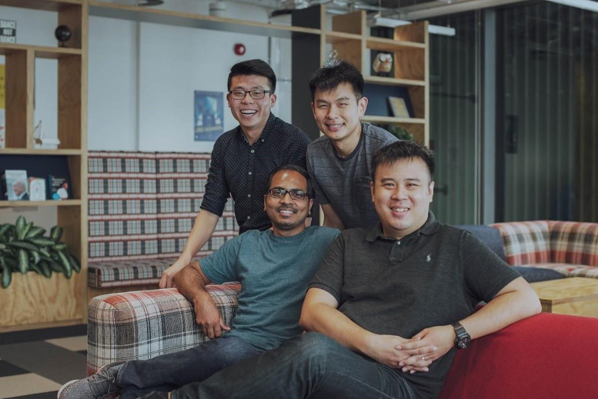 Henry and his colleagues at the Facebook Singapore office